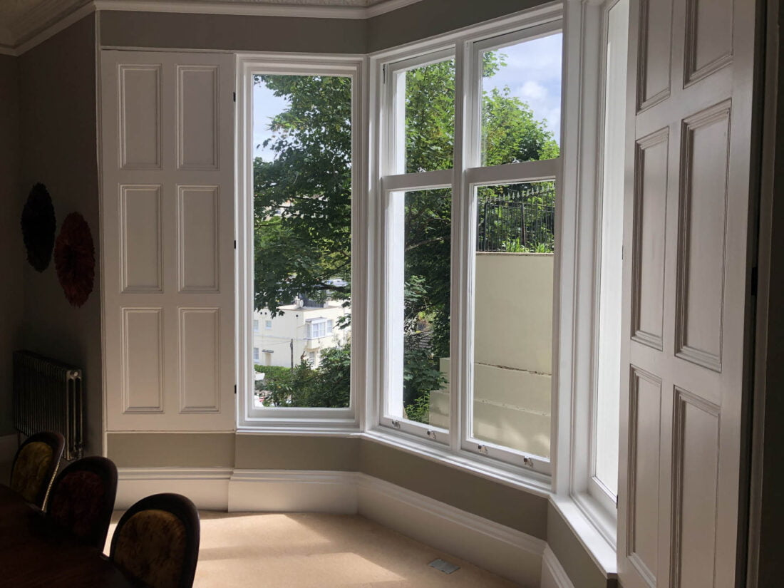Picture of white wooden windows from the inside